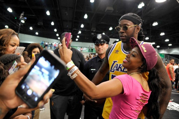 LOS ANGELES, CA - JUNE 27:  Rapper 2 Chainz (C) takes a selfie with fan at the Sprite celebrity basketball game during the 2015 BET Experience at the Los Angeles Convention Center on June 27, 2015 in Los Angeles, California.  (Photo by John Sciulli/BET/Getty Images for BET)