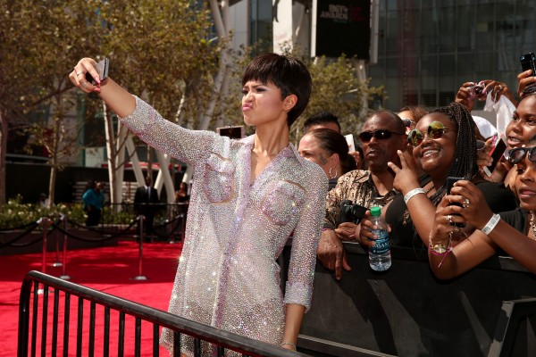 LOS ANGELES, CA - JUNE 28:  Recording artist Zendaya poses on the red carpet for a selfie photo with fans at the 2015 BET Awards at the Microsoft Theater on June 28, 2015 in Los Angeles, California.  (Photo by Christopher Polk/BET/Getty Images for BET)