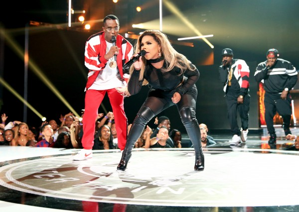 LOS ANGELES, CA - JUNE 28:  Recording artists Diddy (L) and Lil' Kim perform onstage during the 2015 BET Awards at the Microsoft Theater on June 28, 2015 in Los Angeles, California.  (Photo by Christopher Polk/BET/Getty Images for BET)