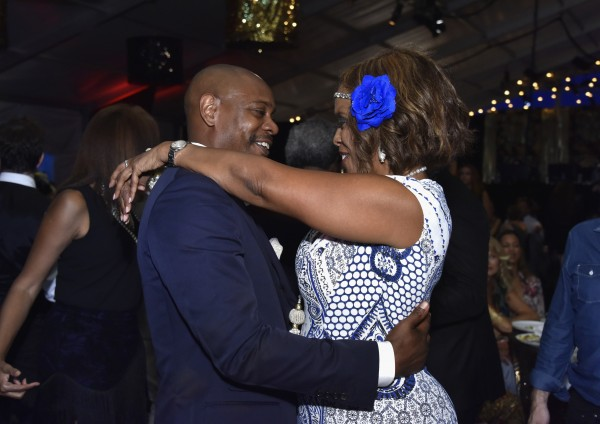 WATER MILL, NY - JULY 18:  Dave Chappelle and  Gayle King attend as RUSH Philanthropic Arts Foundation Celebrates 20th Anniversary at Art For Life sponsored by Bombay Sapphire Gin at Fairview Farms on July 18, 2015 in Water Mill, New York.  (Photo by Eugene Gologursky/Getty Images for Bombay Sapphire Gin)