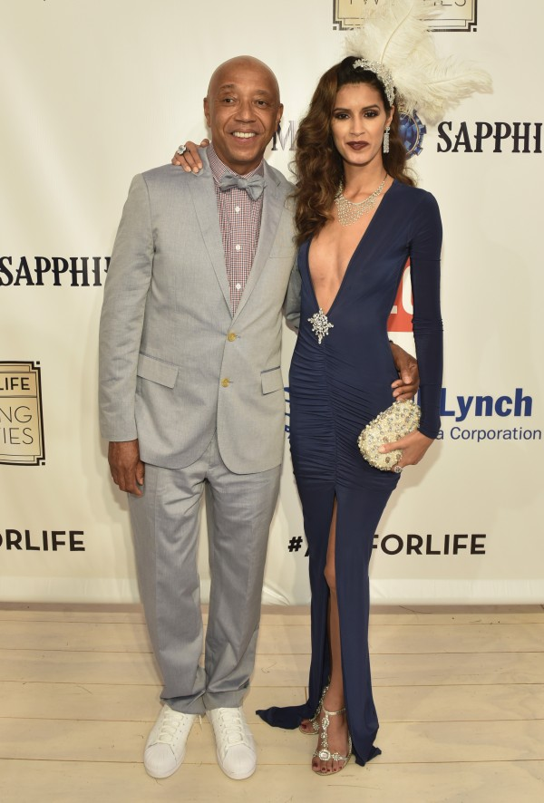 WATER MILL, NY - JULY 18: Russell Simmons and Jaslene Gonzalez attend as RUSH Philanthropic Arts Foundation Celebrates 20th Anniversary at Art For Life sponsored by Bombay Sapphire Gin at Fairview Farms on July 18, 2015 in Water Mill, New York.  (Photo by Eugene Gologursky/Getty Images for Bombay Sapphire Gin)