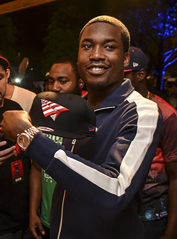 Meek Mill at the New Era booth at Made In America festival in Philadelphia, Pa., on Saturday, August 5.