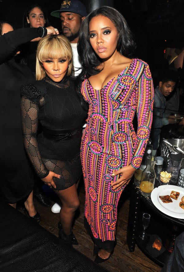NEW YORK, NY - DECEMBER 10: Lil' Kim and Angela Simmons attend as WE tv Celebrates The Premiere Of New Series Growing Up Hip Hop on December 10, 2015 in New York City. (Photo by D Dipasupil/Getty Images for WE tv)