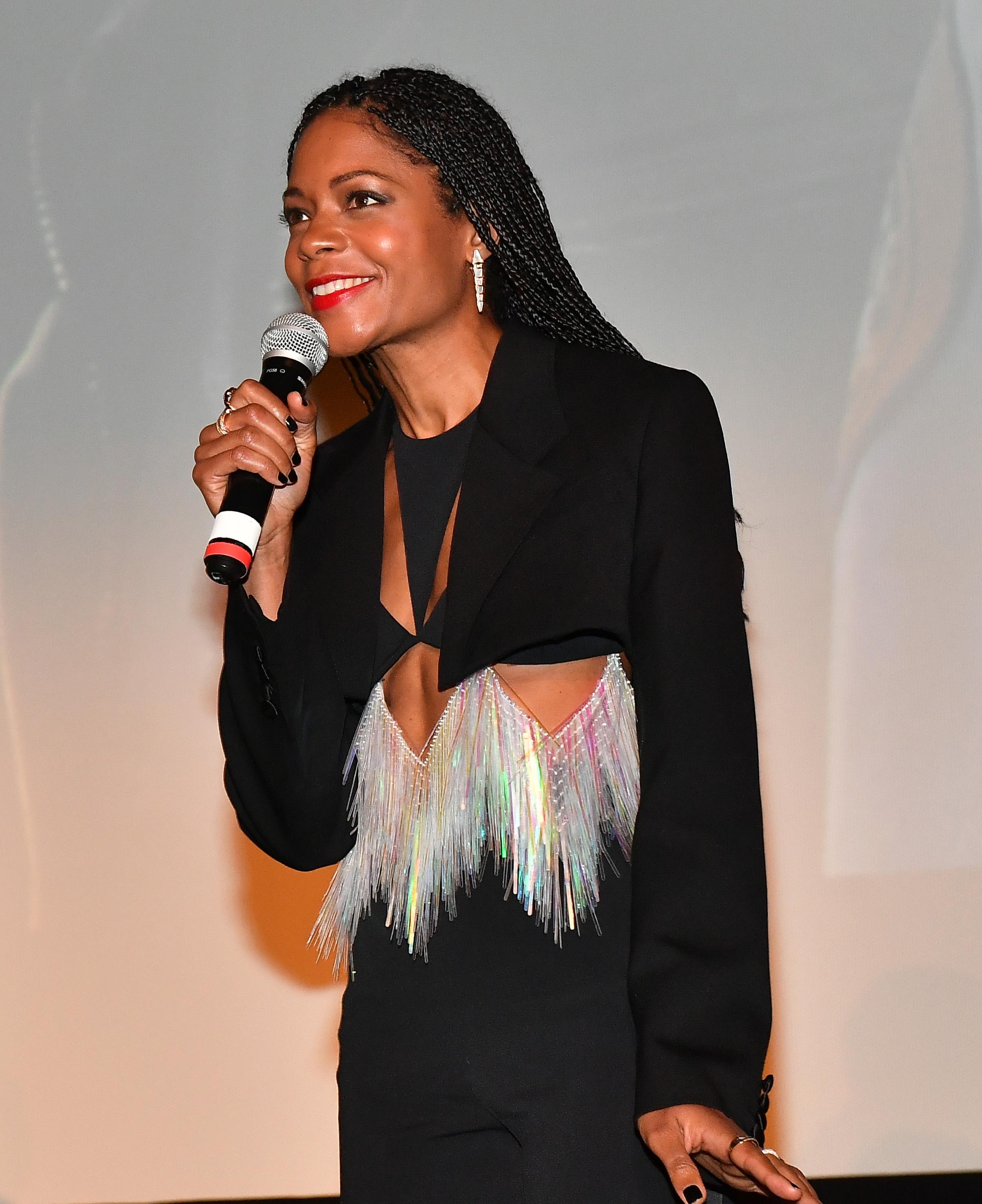 Wardrobe Breakdown: Naomi Harris At Black And Blue Premiere In Atlanta