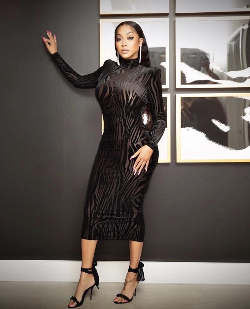 Wardrobe Breakdown: LaLa Anthony At T.I.'s 40th Birthday